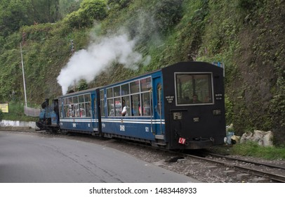 Kurseong, Darjeeling: May 29 2019: The toy train pulled by steam locomotive  between Ghoom and Darjeeling passes through the most scenic route in the himalayas.