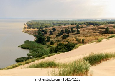 Kursiu Nerija National Park is a narrow strip of sand stretching 97 kilometres along the Baltic Sea in western Lithuania. The eastern shores of the Curonian Spit are washed by the Curonian Lagoon.