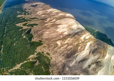 Kursiu Nerija National Park is a narrow strip of sand stretching along the Baltic Sea in western Lithuania. The eastern shores of the Curonian Spit are washed by the Curonian Lagoon. View above.