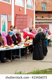 KURSK APRIL 30: - Russian Orthodox Church priest sprinkle holy water  Easter cakes and eggs of believers for Easter in the oldest church of  Kursk.