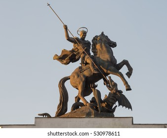 """Kursk city, Russia - May. 4, 2016: The statue of Martyr St. George on the top of the triumphal arch, memorial complex """"Kurskaya duga"""""""