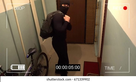 Kursk,Russia,June 30 :surveillance camera caught the robber in a mask running off with a bag of loot,shows the camera the middle finger.