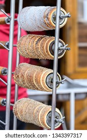 Kurtos kalacs (Chimney Cakes) on display on roll spinning at a local Hungarian market stand, traditional food