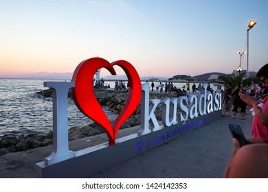 Kusadasi, izmir/Turkey: June 7, 2019: the sunset at Kusadasi is photographic event and people try to shoot it at Kusadasi, Turkey