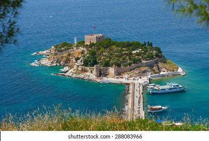 "KUSADASI, TURKEY - 24 MAY 2012: Pigeon Island with a ""Pirate castle"". The island is place of birds during the seasonal migrations. Kusadasi harbor, Aegean coast of Turkey."