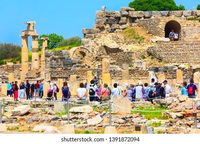 Kusadasi, Turkey - April 28, 2019: People visiting old ruins of Ephesus or Efes famous site