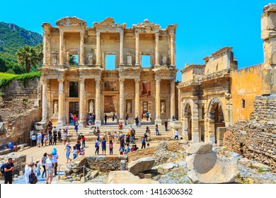 Kusadasi, Turkey - April 28, 2019: People visiting Celsus Library and old ruins of Ephesus or Efes famous site