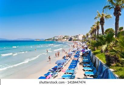 KUSADASI, TURKEY - AUGUST 4, 2011: Ladies Beach, known in Turkish as Kadinlar Denizi, is one of the most popular and busiest beaches in Kusadasi.