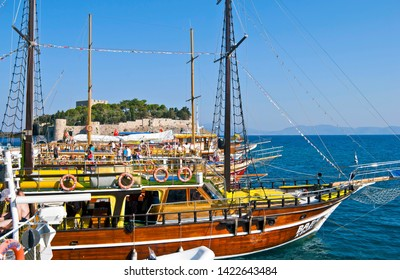 KUSADASI, TURKEY - JULY 31, 2011: Tourist ships ready to go in a summer morning from Kusadasi, Turkey. Aegean Turkish Riviera attracts every year a large number of tourists.