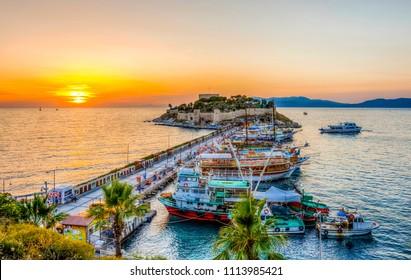 Kusadasi, Turkey - June 13, 2018 : The road goes to Pigeon Island in Kusadasi. Kusadasi is a popular tourist destination in Turkey.