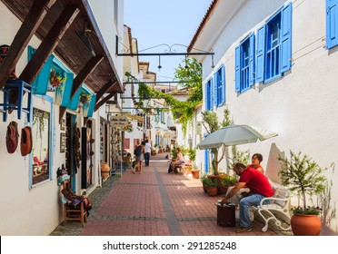 KUSADASI, TURKEY- JUNE 13: Shopping street of Kusadasi, Turkey on June 13, 2015. There are lots of tourist shops around the streets of Kusadasi that sell souvenirs and fake designer clothes.