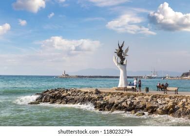 KUSADASI, TURKEY - JUNE 22, 2018: Hand of Peace Sculpture in Kusadasi, Turkey in a beautiful summer day