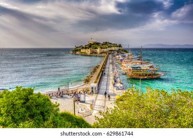 Kusadasi, Turkey - March 31, 2017 : The road goes to Pigeon Island in Kusadasi. Kusadasi is a popular tourist destination in Turkey.