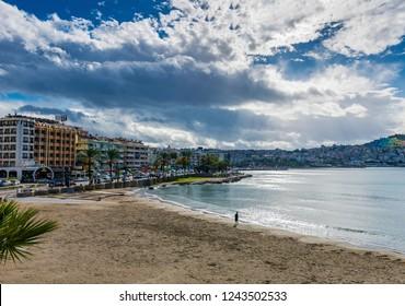 Kusadasi, Turkey - November 28, 2018 : Engelsiz Beach view from marina in Kusadasi Town