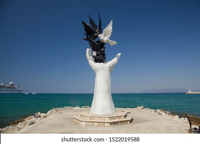 Kusadasi, Turkey - September 17, 2019: The hand of peace sculpture with doves in Kusadasi, Turkey.