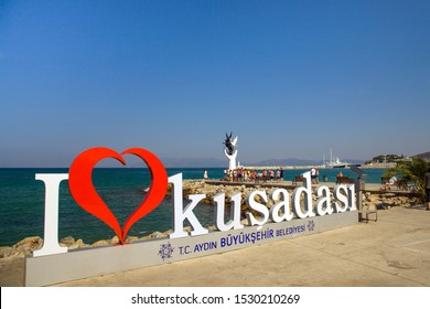 Kusadasi, Turkey - September 17, 2019: The marina in Kusadasi. The coast and port in the city, fishing boats and tourist ship. Place of holiday photos.