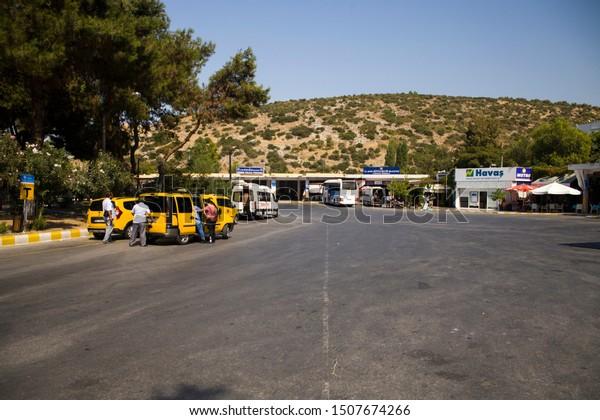 Kusadasi, Turkey - September 17, 2019: Bus station in Kusadasi, Turkey. Coach and dolmus stop and taxi.