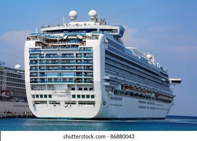 KUSADASI, TURKEY - SEPTEMBER 21: Grand-class cruise ship Ruby Princess at the harbor on September 21, 2011 in Kusadasi, Turkey. The ship was built in 2008 and cost about 400 million dollars.
