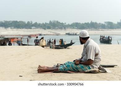 Kushtia, Bangladesh - February 22, 2014: A beggar is begging on a  street at Kushtia, Bangladesh.