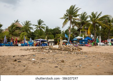 Kuta, Bali, Indonesia - December 18, 2016: A view of Kuta Beach in Bali Indonesia with garbage and debris washed ashore and polluting the sands and water.