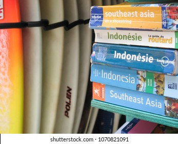 KUTA BEACH, BALI - OCTOBER 19 2007: Lonely Planet and Rough Guide Travel guides for southeast asia and indonesia for sale in shop renting surfboards in kuta