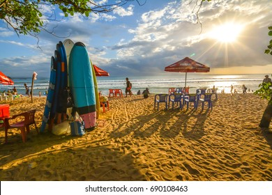 Kuta, Indonesia - July 30, 2017: A large crowd of tourists enjoy the sunset on Kuta beach in Bali. The island is famous for its nightlife.