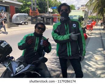 KUTA,BALI, INDONESIA - SEPTEMBER 13, 2018:  Biker wearing jacket with Gojek Logo. Gojek is Indonesian transportation startup