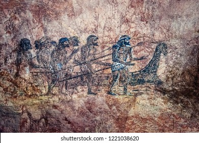 Kutaisi / Georgia -  07 September, 2018: Prehistoric cave drawing with the image of ancient people or hunters, next to a dinosaur