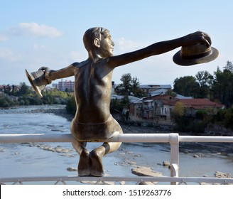 KUTAISI GEORGIA 09 19 2019: 'Picasso's boy'  Sculpture of Boy with hats on  White Bridge of Rioni River, Kutaisi, Imereti Province (Mkhare)