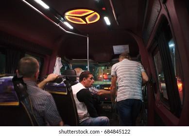 Kutaisi, Georgia - June 07, 2017: People ride a public transport mini bus at night.