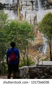 Kutaisi, Georgia - September 26, 2019: Tourist man is enjoying the view of Kinchkha Waterfall
