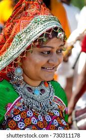 KUTCH, GUJARAT, INDIA - 6 NOV. 2014: Young Beautiful Gujarati Kutchi village girl wearing colorful embroidered costume at Rann of Kutch.