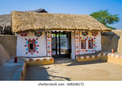 KUTCH, INDIA - DECEMBER. 27 2016: Exterior of a decorative entrance of house built with straw, mud and stone at village in Kutch, Gujarat, India
