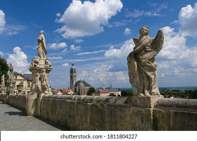 Kutna Hora, Czech Republic - 11 Aug 2010: Panoramic view of Kutna Hora medival city in Bohemia, Czech Republic. Statues in front of Jesuit College in Kutna Hora with St. James Church in background. - Shutterstock ID 1811804227