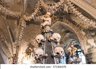 KUTNA HORA, CZECH REPUBLIC - 2 august 2016: Kostnice Sedlec. Decorations in the Church: an angel with wings, a human skull and human bones