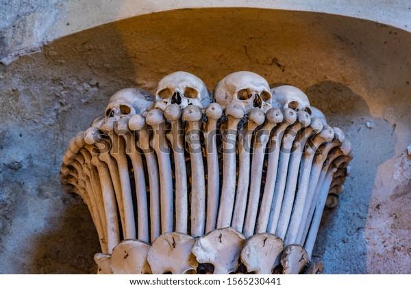KUTNA HORA, CZECH REPUBLIC, APRIL 30, 2019: Decoration made of bones at Seldec ossuary in Kutna Hora, Czech Republic