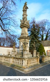 KUTNA HORA, CZECH REPUBLIC - JANUARY 25, 2019: Plague pillar of 18th century near famous Kostnice in Sedlec, Kutna Hora, Czech Republic