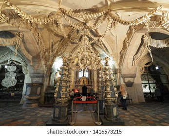 KUTNA HORA, CZECH REPUBLIC - OCTOBER 25, 2018: The Sedlec Ossuary is a small chapel located in Kutna Hora, Czech Republic. It contains the skeletons of between 40,000 and 70,000 people.