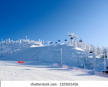 Kuusamo / Finland: Chairlift and slopes in the Ruka ski area on a beautiful and sunny day in February