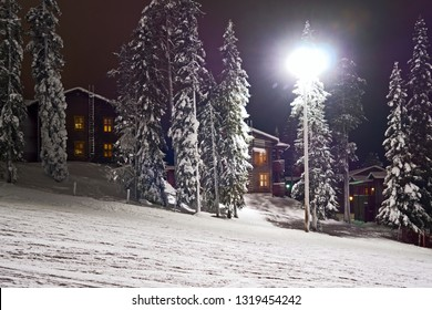 Kuusamo / Finland - February 2019: Aurinko Rinne apartment houses at the edge of the Talvijarvi lift and slope in Ruka on a cold February evening