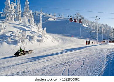 Kuusamo / Finland - February 2019: Lifts and slopes in the Ruka ski area on a beautiful and sunny day in February