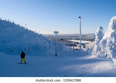 Kuusamo / Finland - February 2019: Magnificent view from Saarua Top downhill to Ruka Village on a beautiful winter day in February