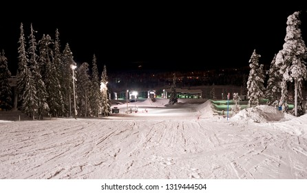 Kuusamo / Finland - February 2019: View from the illuminated Talvijarvi slope down to the lower lift station at Rukan Kaarna on a cold winter evening in February