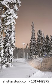 Kuusamo / Finland - February 2019: View from the illuminated Talvijarvi slope to the large ski jumping hill in Ruka on a mystic evening
