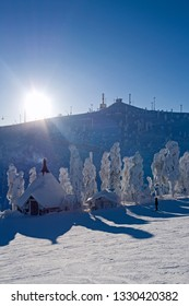 Kuusamo / Finland - February 2019: View from Saatura top with the typical Lapland hut to Rukatunturi top on a beautiful winter day