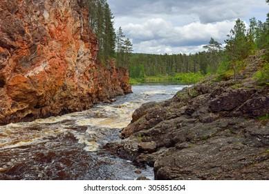 KUUSAMO, FINLAND - JULY 10, 2015: River Oulankajoki is heart of Oulanka National Park. Waters of 135-kilometre-long river originate from Salla mires and actual river begins at Lake Aittajarvi