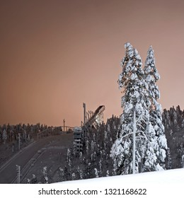 Kuusamo / Finland: The large ski jumping hill in Ruka in mystical evening light