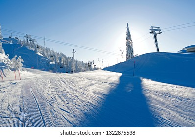 Kuusamo / Finland: Lifts and slopes in the Ruka ski area on a beautiful and sunny day in February