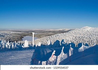 Kuusamo / Finland: Magnificent view to the north from Saarua top in Ruka over Lapland on a beautiful day in February