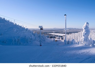 Kuusamo / Finland: Magnificent view from Saarua top downhill to Ruka Village on a beautiful day in February